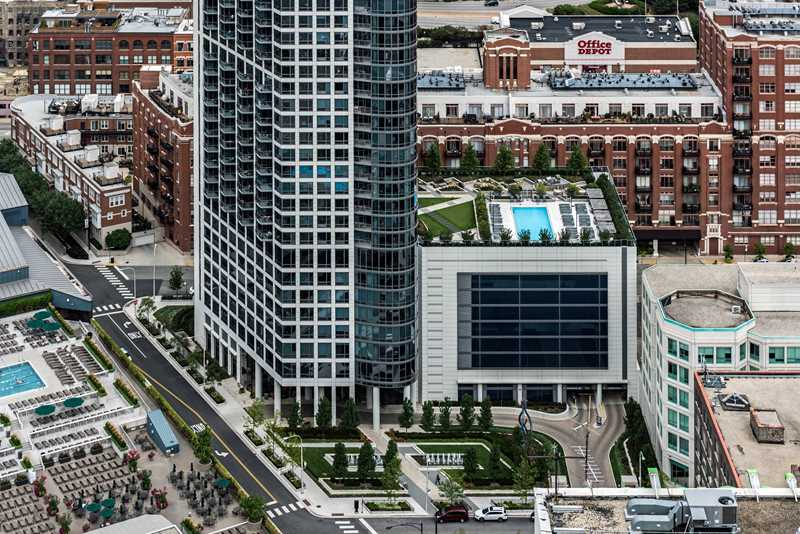 Enjoy the lush pool deck at River North's Hubbard Place apartments