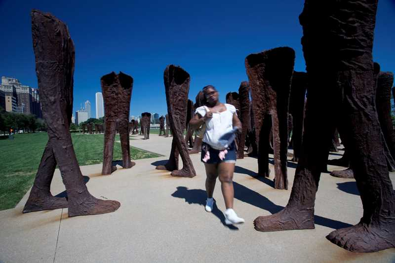 Agora, 106 cast-iron sculptures of torsos with legs in motion by Polish artist Magdalena Abakanowicz, stands, er walks, in Grant Park, near Roosevelt and Michigan.
