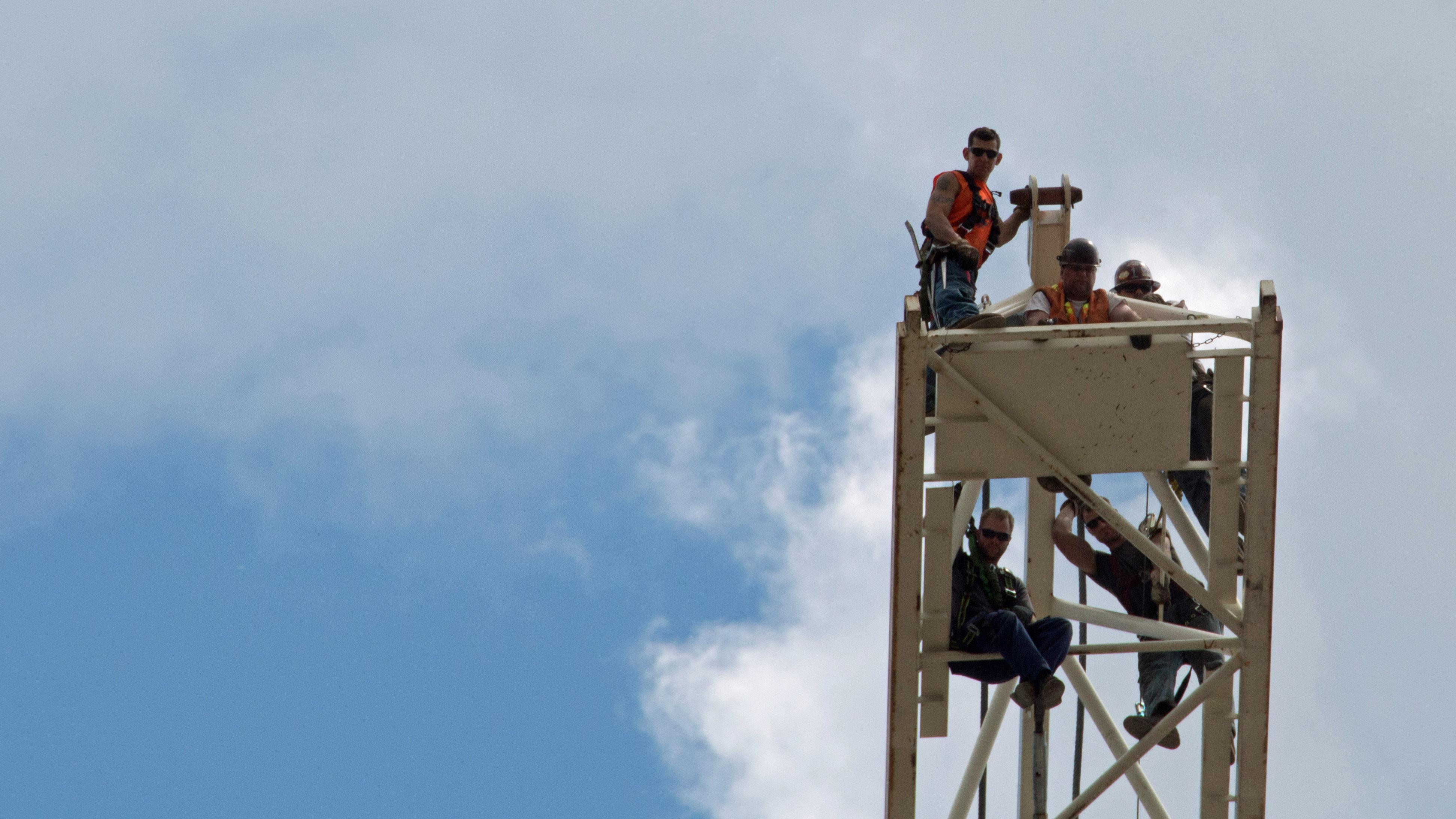 Ironworkers on beam photo Pictured: America s daring