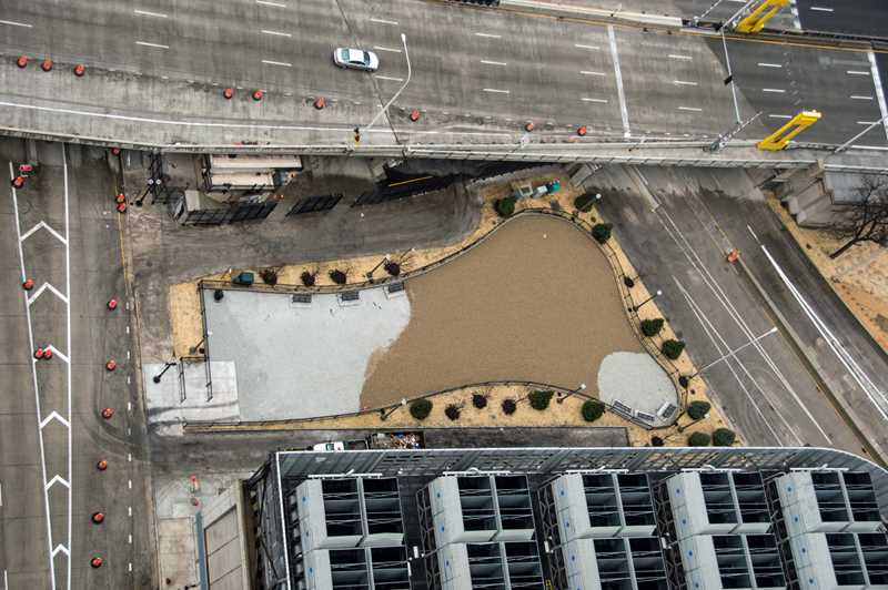 The playfully-shaped dog park at 235 Van Buren