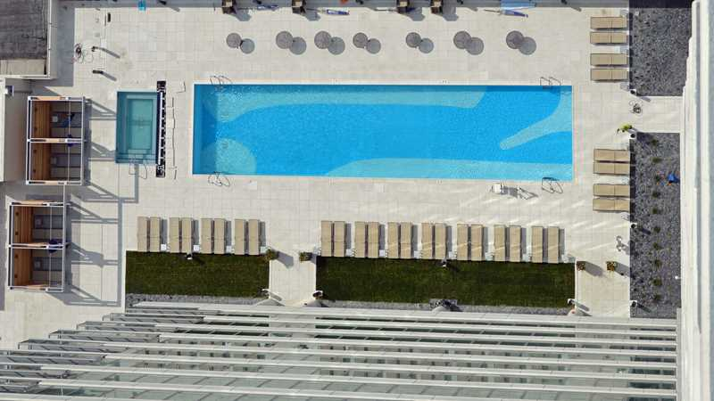 View the sprawling pool deck at K2 Apartments