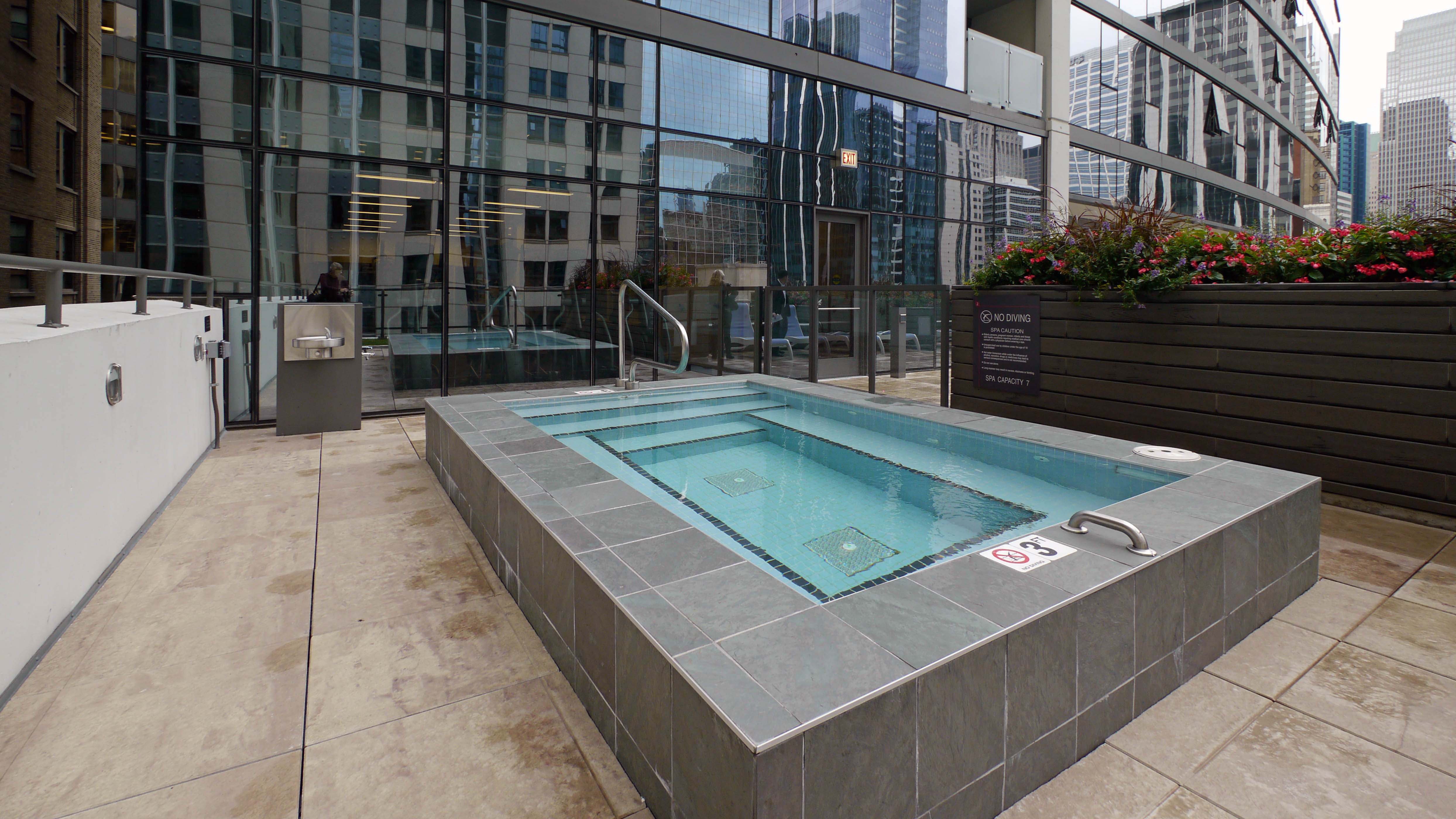 Landscaped sun deck faces south and west and has gas grills with an