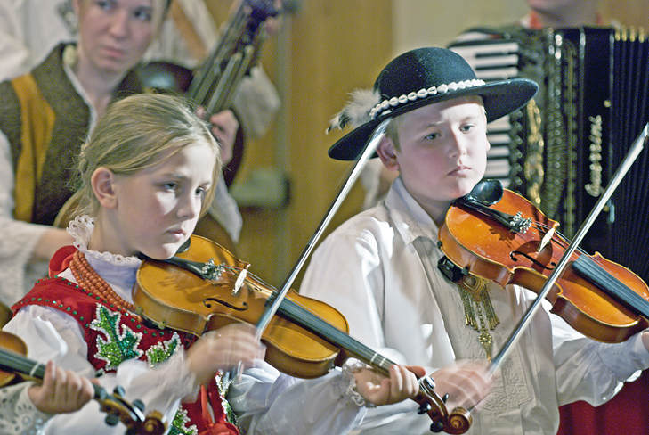 Beata Styrczula, Rafal Stoch and Iwona Staszel (rear) of Wladyslaw Pawlikowski's Young Highlanders' Musician Group, perform at the Polish Highlanders Alliance of North America, 4808 S. Archer Ave.