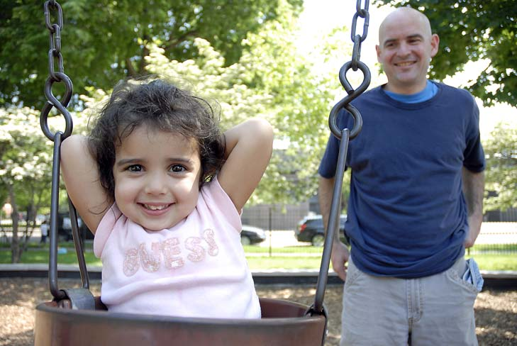 Dave Plomin and his daughter Karma, 3, playing at Skinner Park, 1331 W Adams St