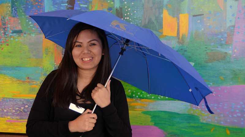 A smile and an umbrella at K2 Apartments