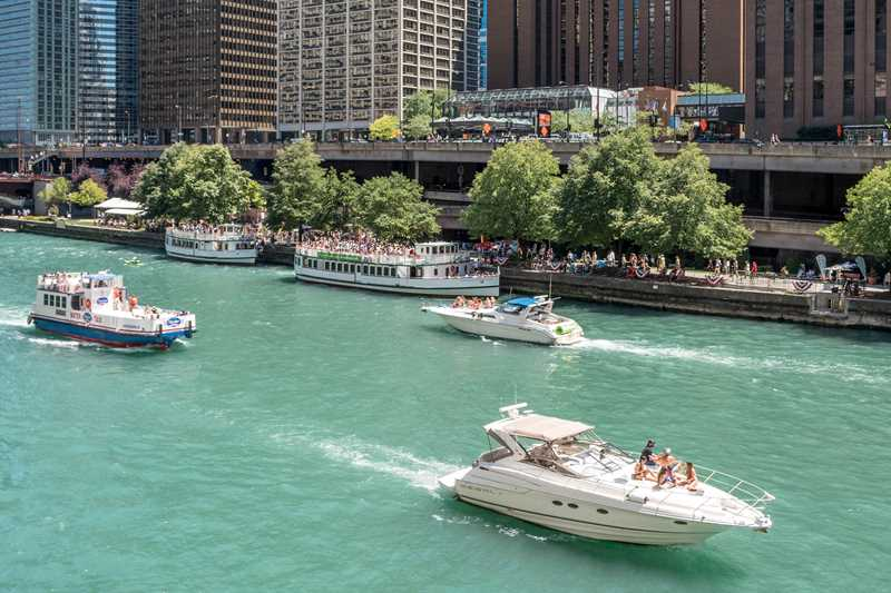 The Riverwalk and Mag Mile are steps from Columbus Plaza apartments