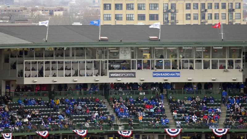 Hear the Cubs fans cheer from your Lakeview balcony