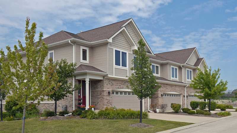 New Palatine townhomes adjacent to Deer Grove Forest Preserve