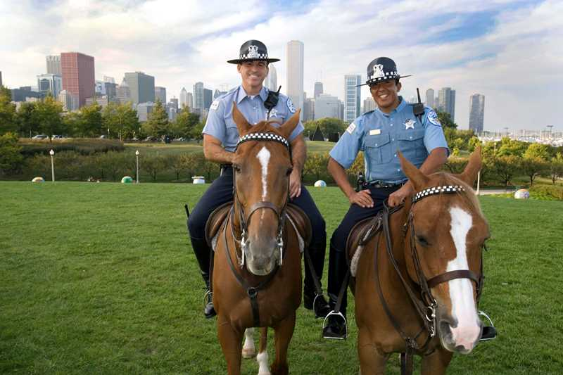 Chicago Police Department mounted officers Casasanto and Ayala patrol the lakefront.