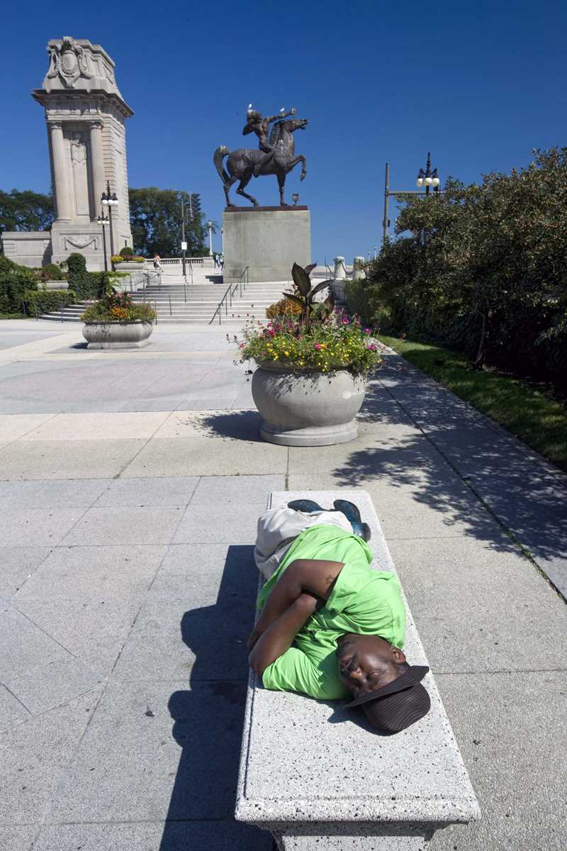 A stone bench in Grant Park provides sunny place for a nap.