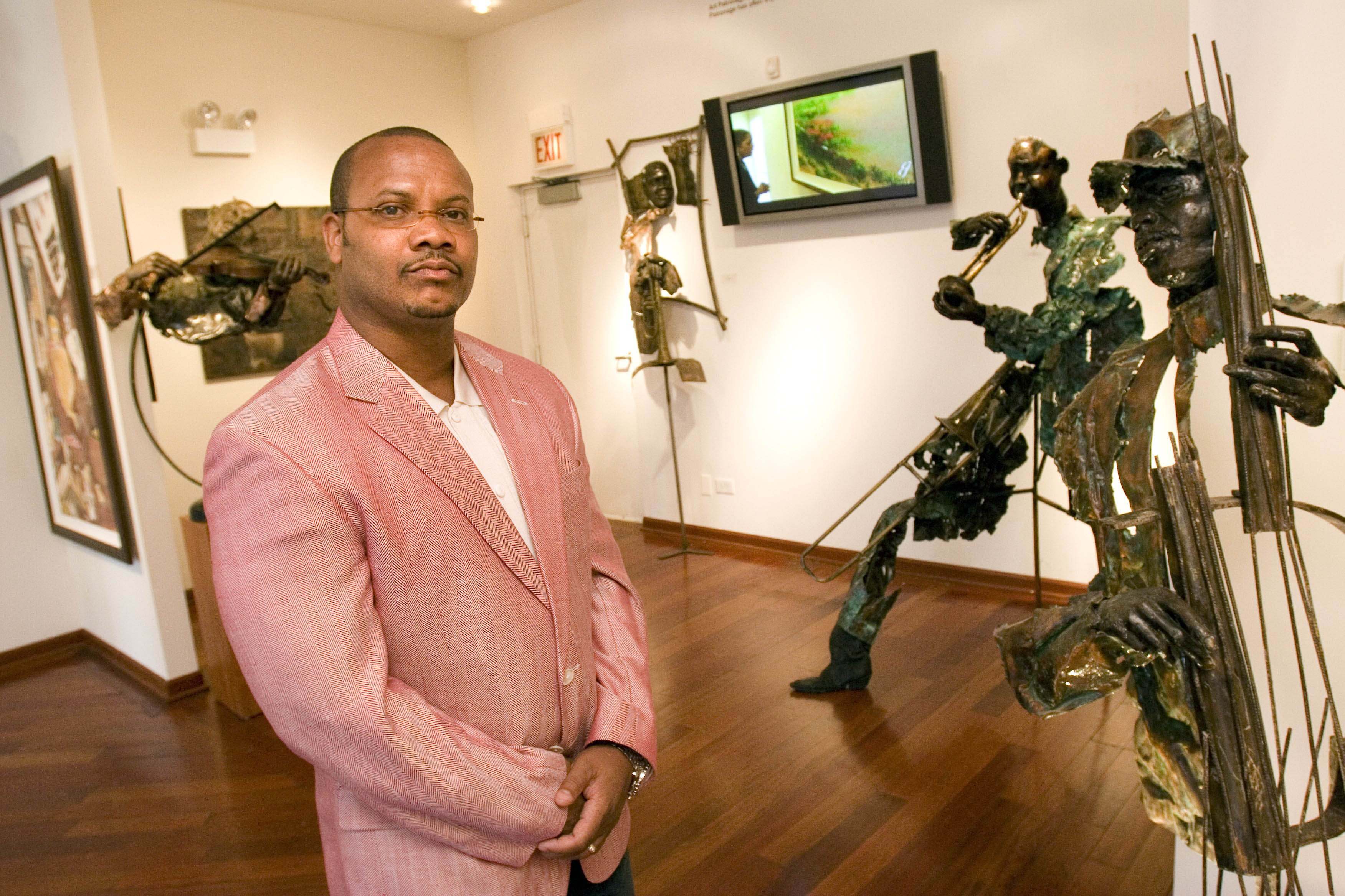 Gallery owner Andre Guichard stands amid the works on display at Gallery Guichard, 3521 S. King Drive.