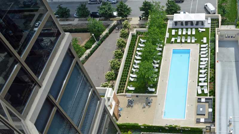 An apartment pool with a view in the Fulton River District