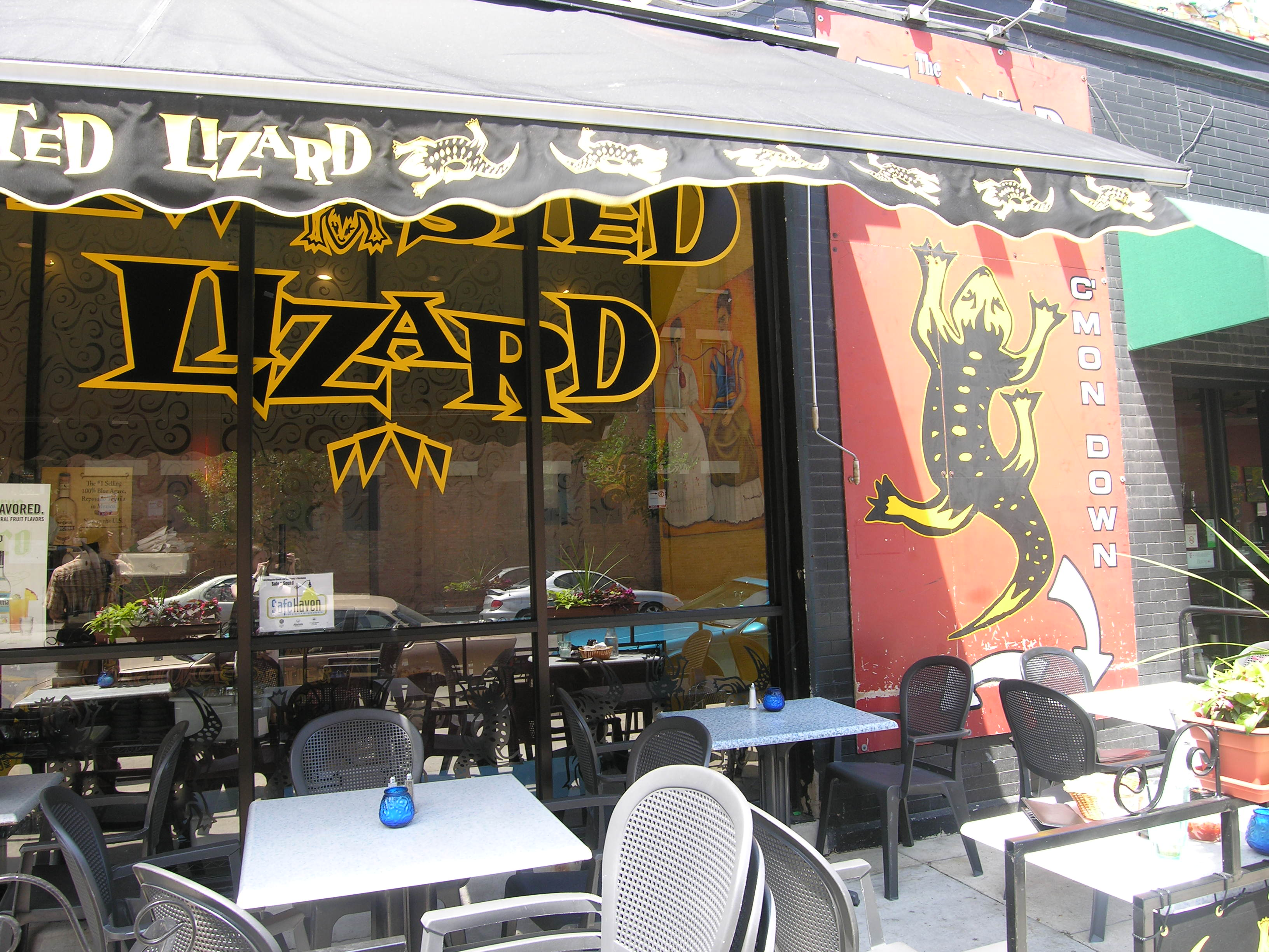 Sizzlin' signs at The Twisted Lizard in Lincoln Park