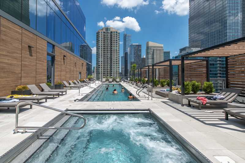 The Riverwalk and theMART are steps from River North's new HUBBARD221