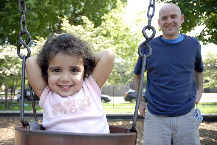Dave Plomin and his daughter Karma, 3, playing at Skinner Park, 1331 W Adams St