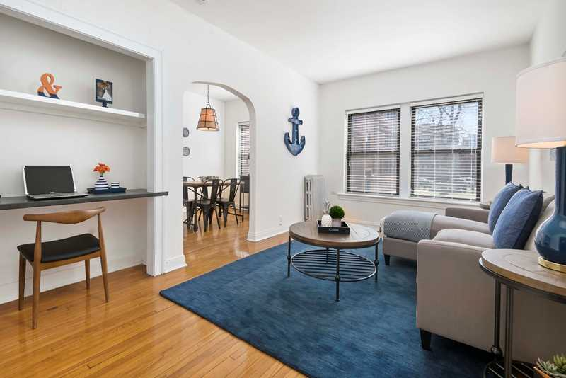 Tour the furnished model at a Lakeview East vintage courtyard