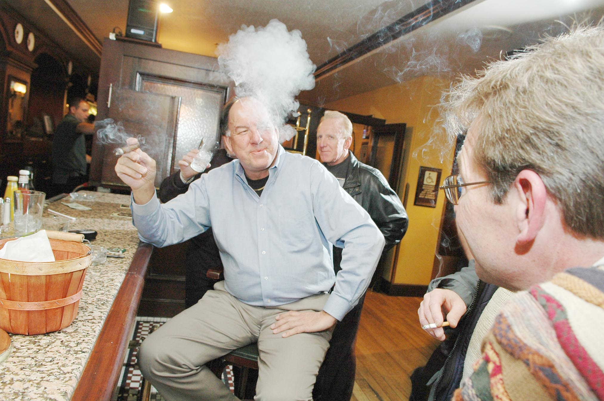 Out-of-towners share a smoke and a laugh at Kitty O'Shea's, 702 S. Michigan Ave.