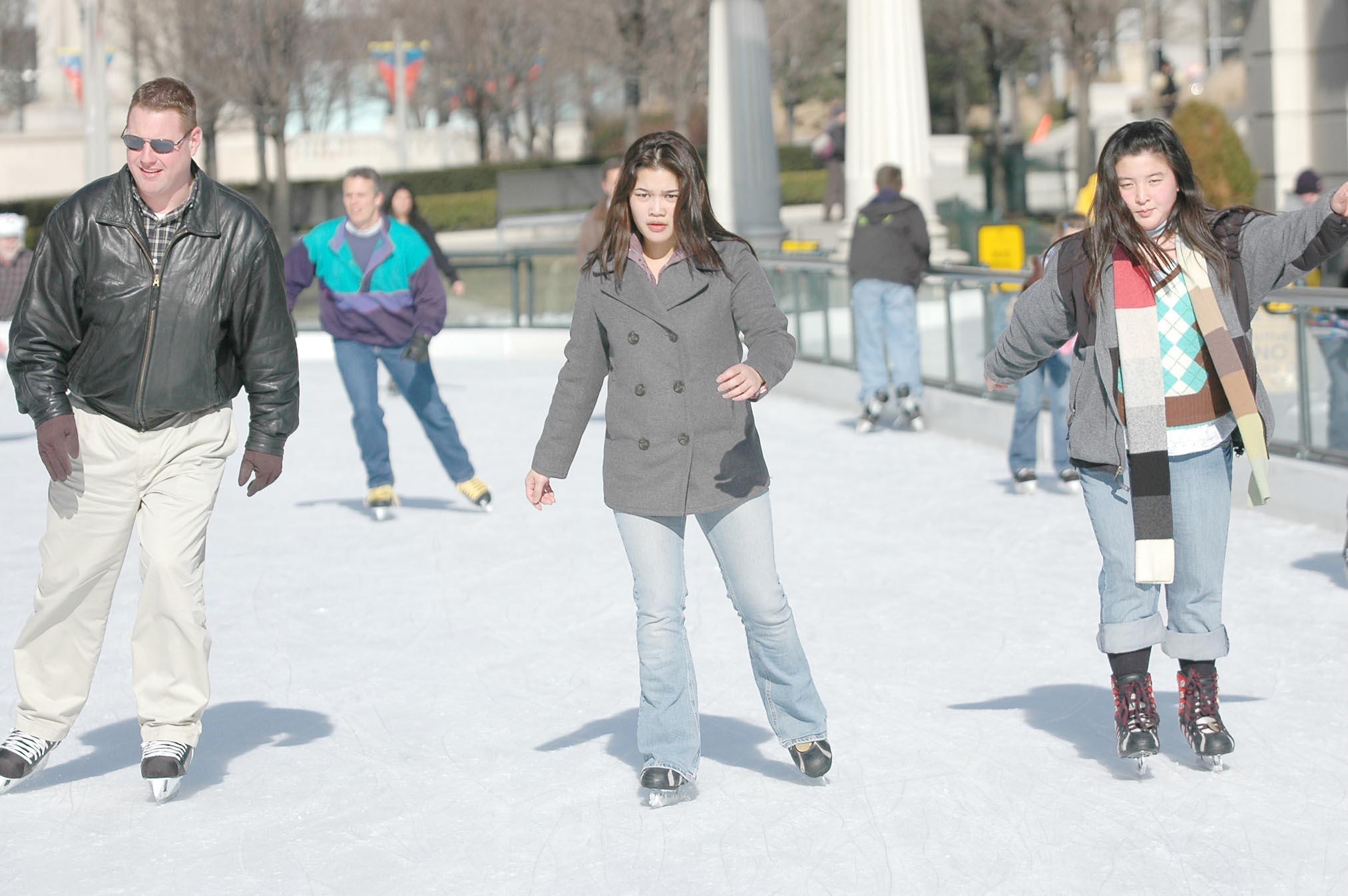 Skaters navigate The McCormick Tribune Ice Rink at Millennium Park.