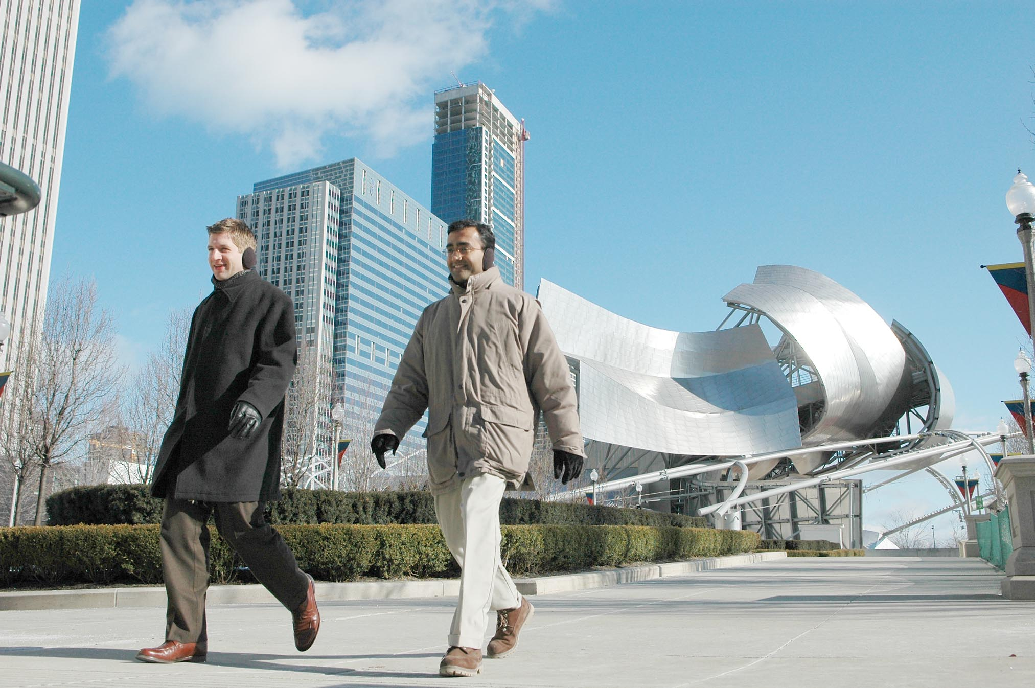 Pedestrians brave the cold in Millennium Park, which has spurred a residential building boom in the Loop.