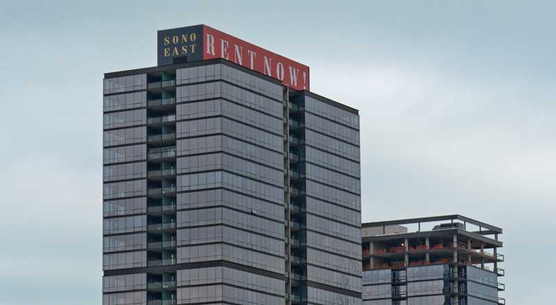 Sign atop SoNo says RENT NOW at SoNo East