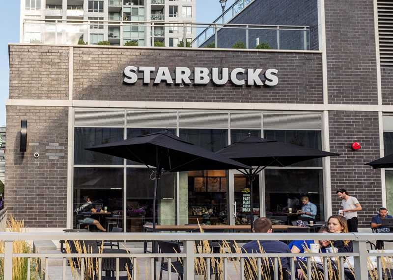 Luxury River North apartments at The Hudson have Starbucks on-site