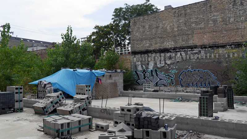 A homeless man builds a shelter in Wicker Park